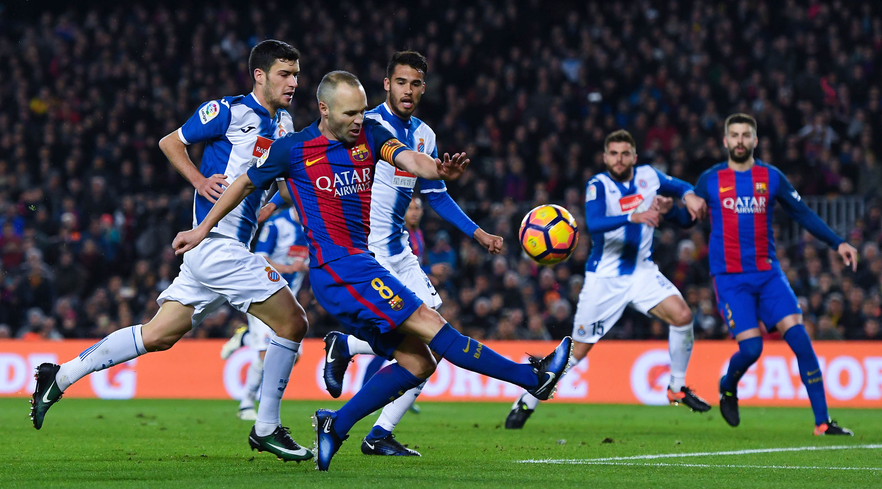 BARCELONA, SPAIN - DECEMBER 18: Andres Iniesta of FC Barcelona shoots towards goal during the La Liga match between FC Barcelona and RCD Espanyol at the Camp Nou stadium on December 18, 2016 in Barcelona, Spain. (Photo by David Ramos/Getty Images)