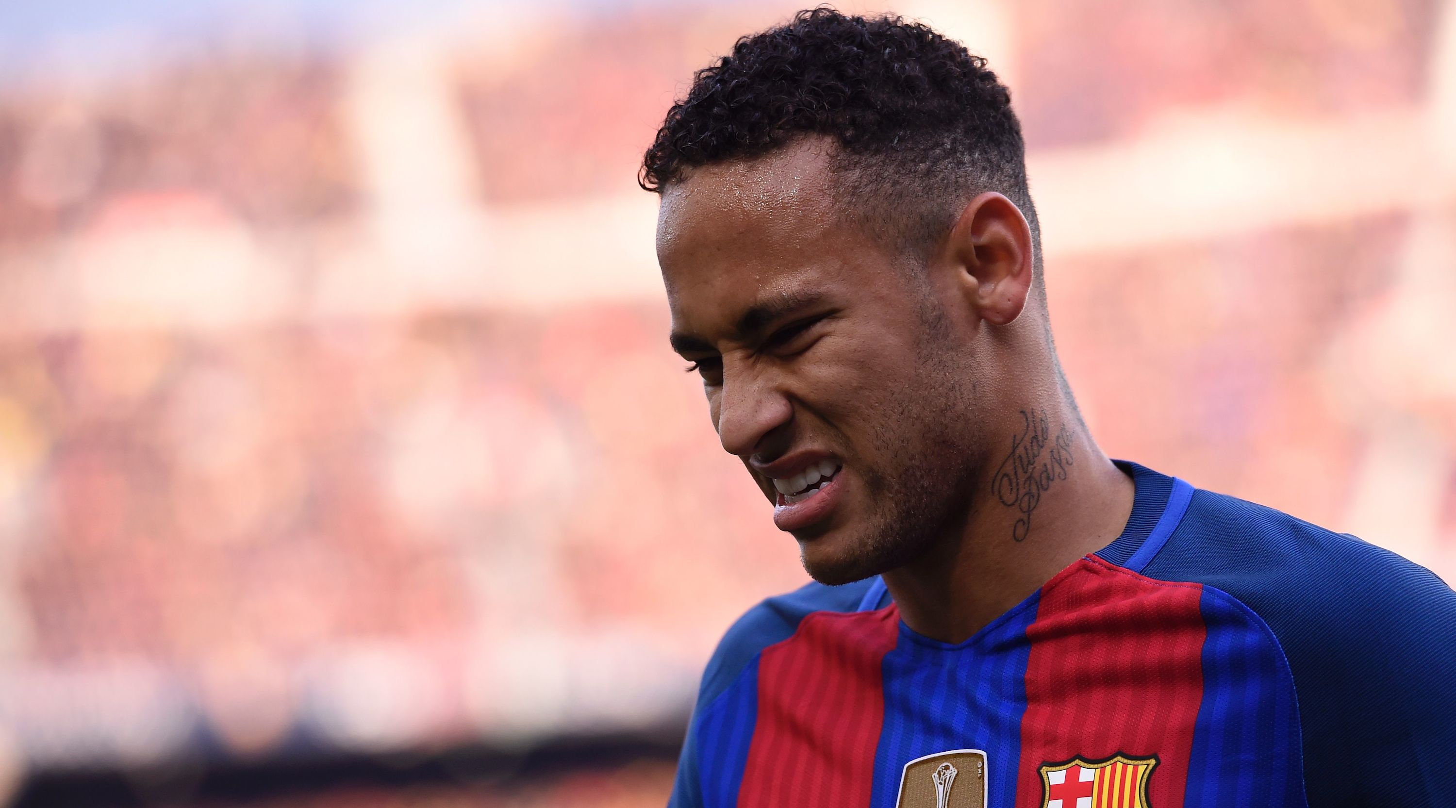 Barcelona's Brazilian forward Neymar reacts after a collision with Real Madrid's defender Dani Carvajal during the Spanish league football match FC Barcelona vs Real Madrid CF at the Camp Nou stadium in Barcelona on December 3, 2016. / AFP / JOSEP LAGO (Photo credit should read JOSEP LAGO/AFP/Getty Images)