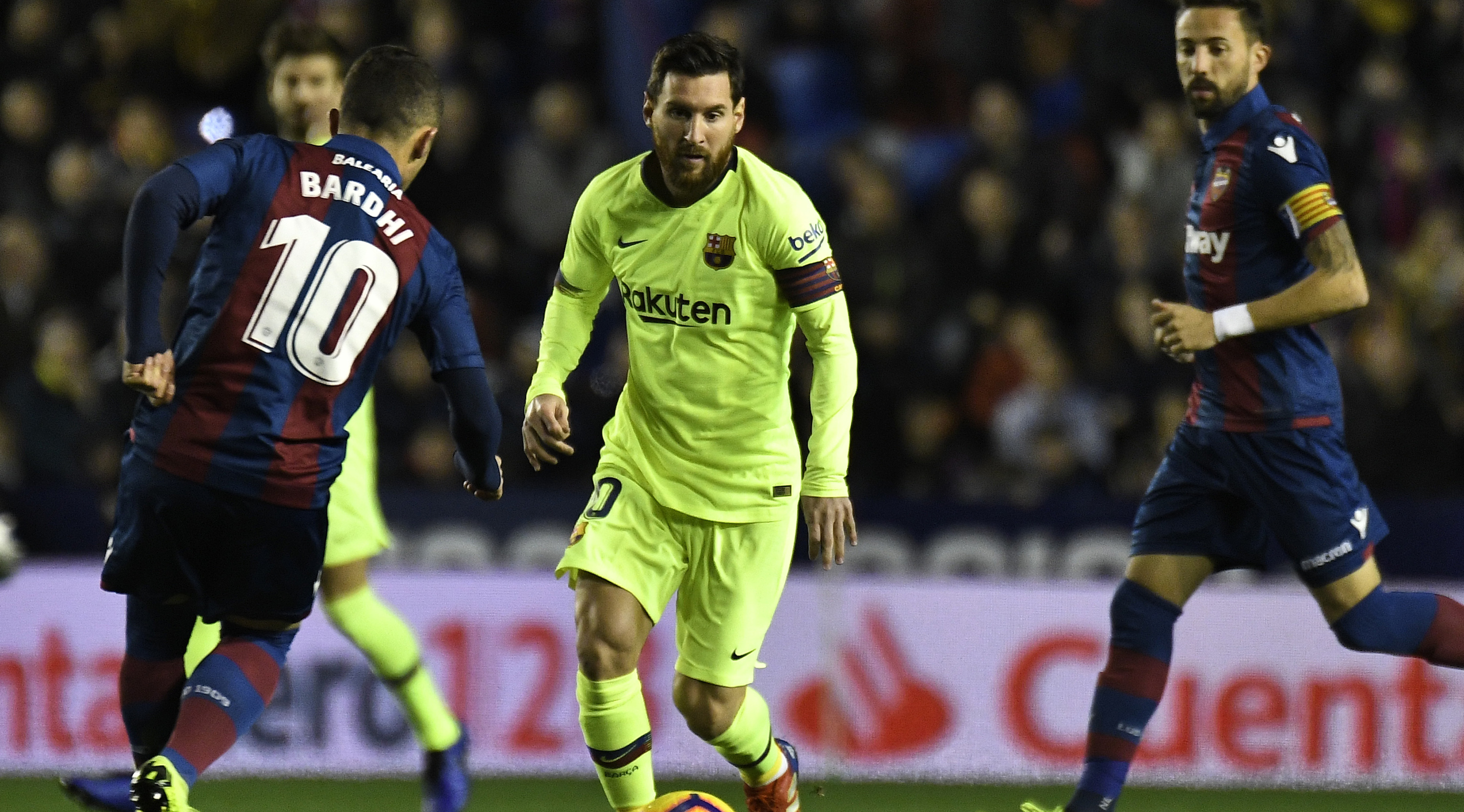 Levante's Macedonian midfielder Enis Bardhi (L) vies with Barcelona's Argentinian forward Lionel Messi during the Spanish League football match between Levante and Barcelona at the Ciutat de Valencia stadium in Valencia on December 16, 2018. (Photo by JOSE JORDAN / AFP) (Photo credit should read JOSE JORDAN/AFP/Getty Images)