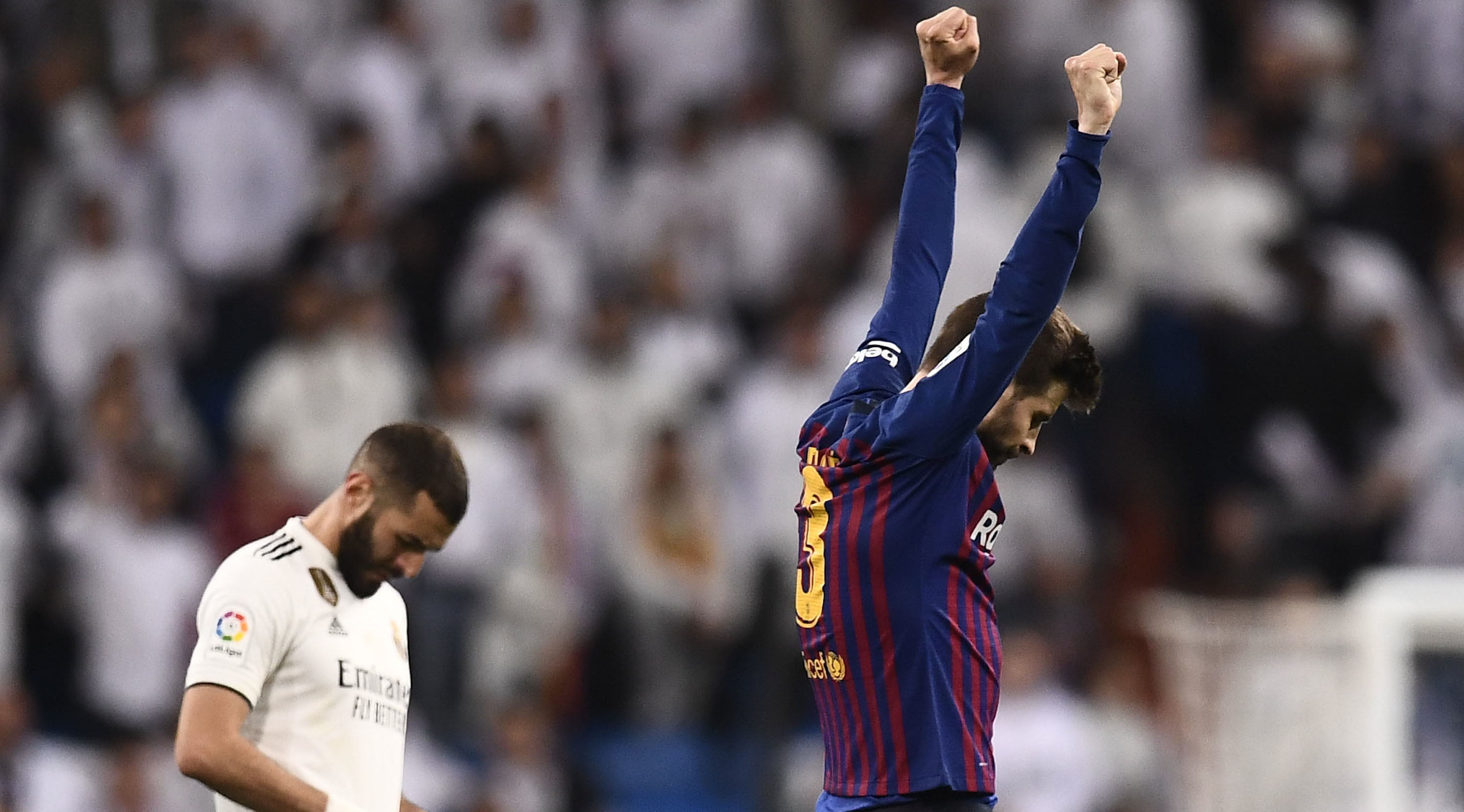 Barcelona's Spanish defender Gerard Pique celebrates during the Spanish league football match between Real Madrid CF and FC Barcelona at the Santiago Bernabeu stadium in Madrid on March 2, 2019. (Photo by OSCAR DEL POZO / AFP) (Photo credit should read OSCAR DEL POZO/AFP/Getty Images)