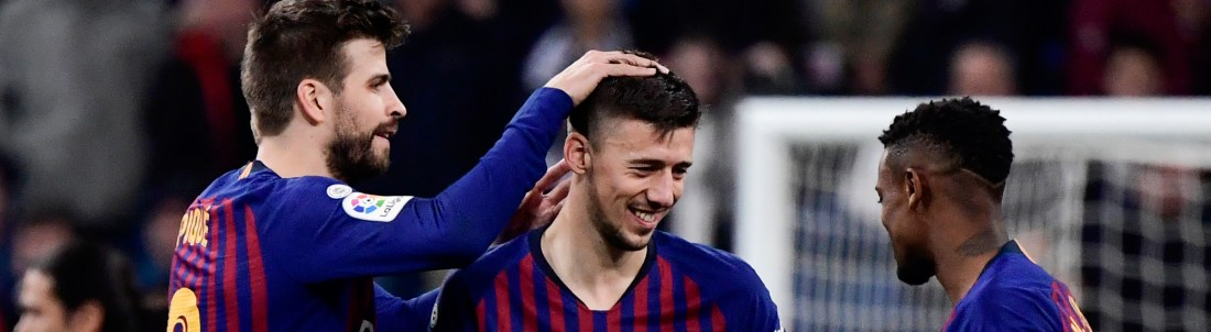 Barcelona's Spanish defender Gerard Pique, Barcelona's French defender Clement Lenglet and Barcelona's French forward Ousmane Dembele celebrate at the end of the Spanish league football match between Real Madrid CF and FC Barcelona at the Santiago Bernabeu stadium in Madrid on March 2, 2019. (Photo by JAVIER SORIANO / AFP) (Photo credit should read JAVIER SORIANO/AFP/Getty Images)