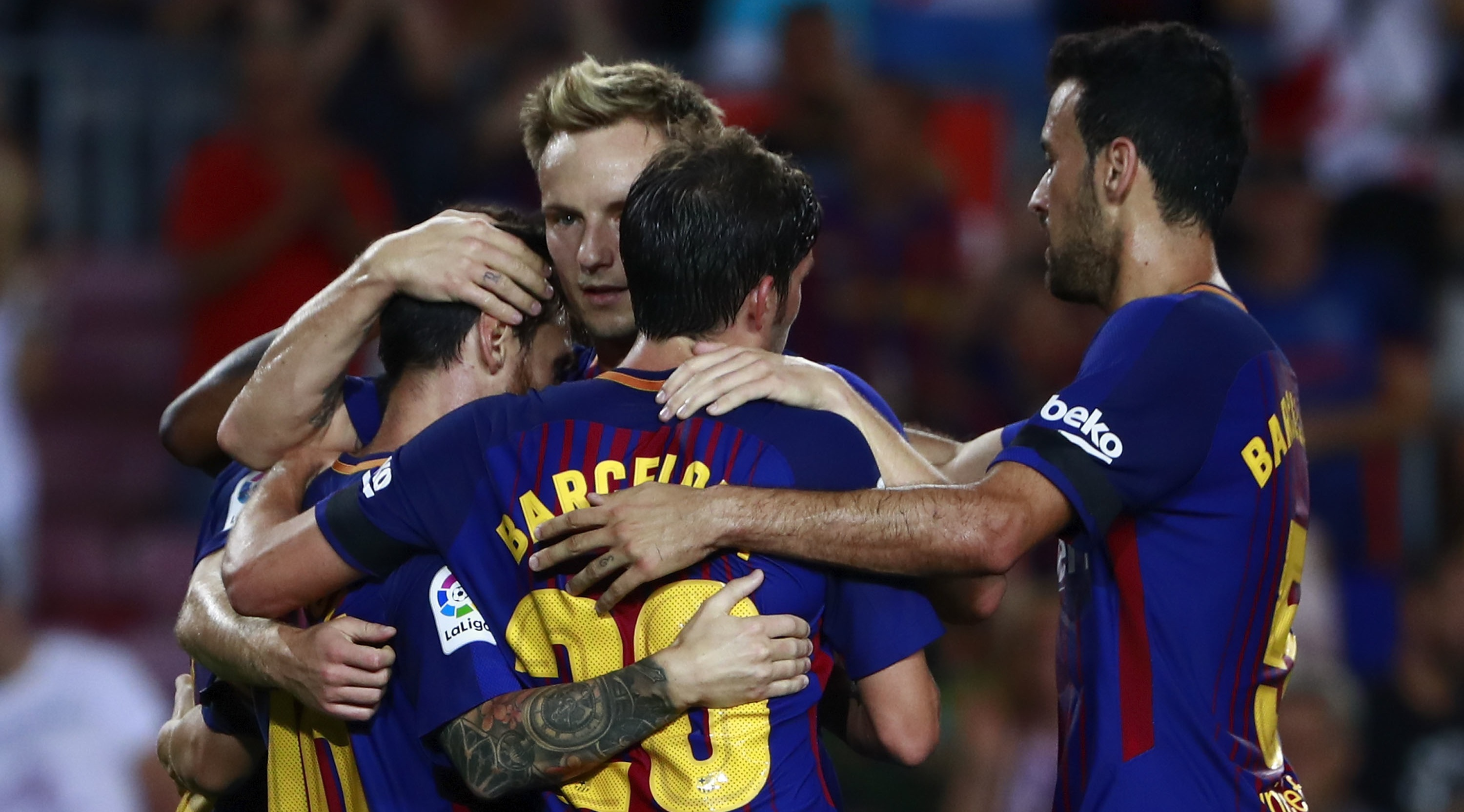 BARCELONA, SPAIN - AUGUST 20: Lionel Messi (L) of FC Barcelona celebrates scoring their opening goal with teammates Sergi Roberto (3ndL) Sergio Busquets Burgos (R) and Ivan Rakitic (2ndL) during the La Liga match between FC Barcelona and Real Betis Balompie at Camp Nou stadium on August 20, 2017 in Barcelona, Spain. (Photo by Gonzalo Arroyo Moreno/Getty Images)