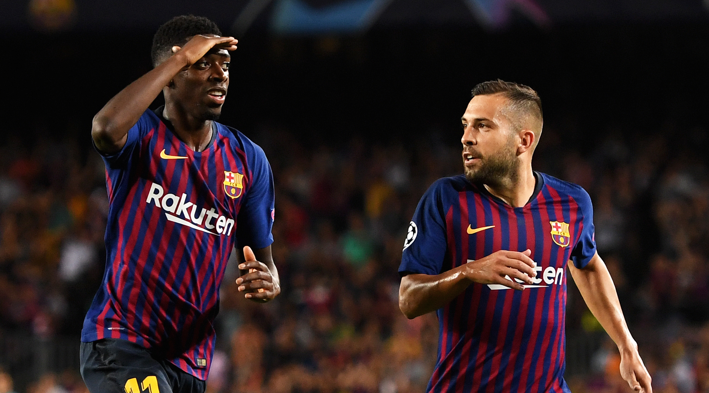Ousmane Dembele of Barcelona celebrates with teammate Jordi Alba after scoring his team's second goal during the Group B match of the UEFA Champions League between FC Barcelona and PSV at Camp Nou on September 18, 2018 in Barcelona, Spain. (Photo by Alex Caparros/Getty Images)