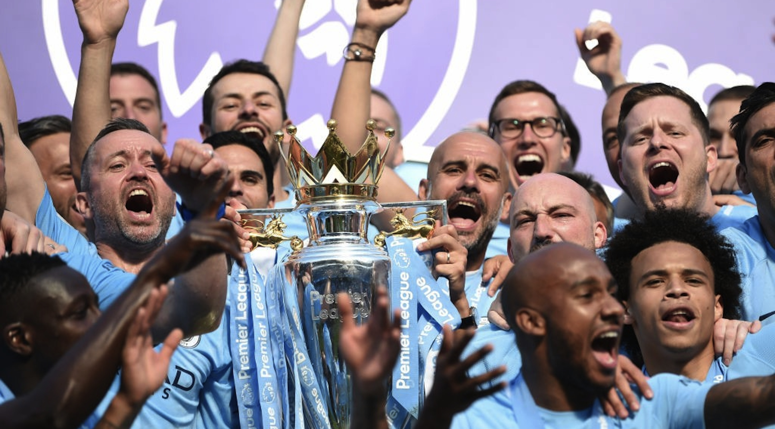 Josep Guardiola, Manager of Manchester City lifts The Premier League Trophy after the Premier League match between Manchester City and Huddersfield Town at Etihad Stadium on May 6, 2018 in Manchester, England. (Photo by Michael Regan/Getty Images)