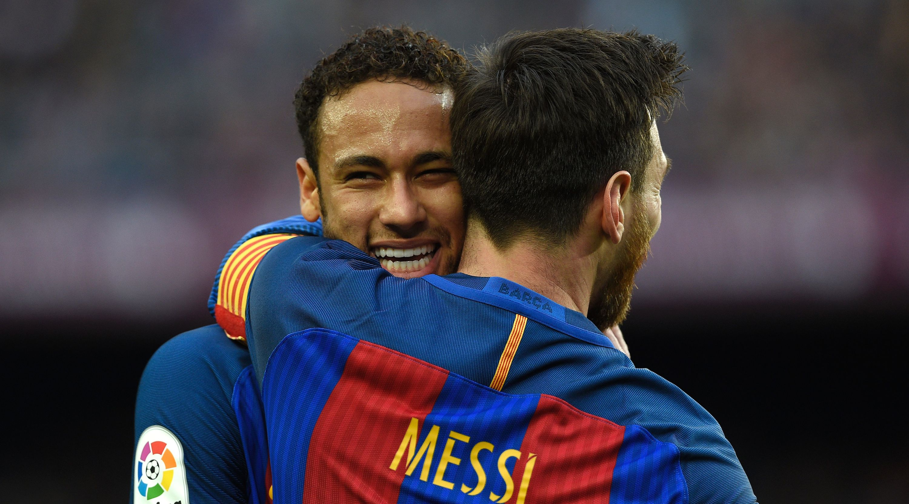 Barcelona's Argentinian forward Lionel Messi (R) celebrates a goal with Barcelona's Brazilian forward Neymar during the Spanish league football match FC Barcelona vs Athletic Club Bilbao at the Camp Nou stadium in Barcelona on February 4, 2017. / AFP / LLUIS GENE (Photo credit should read LLUIS GENE/AFP/Getty Images)