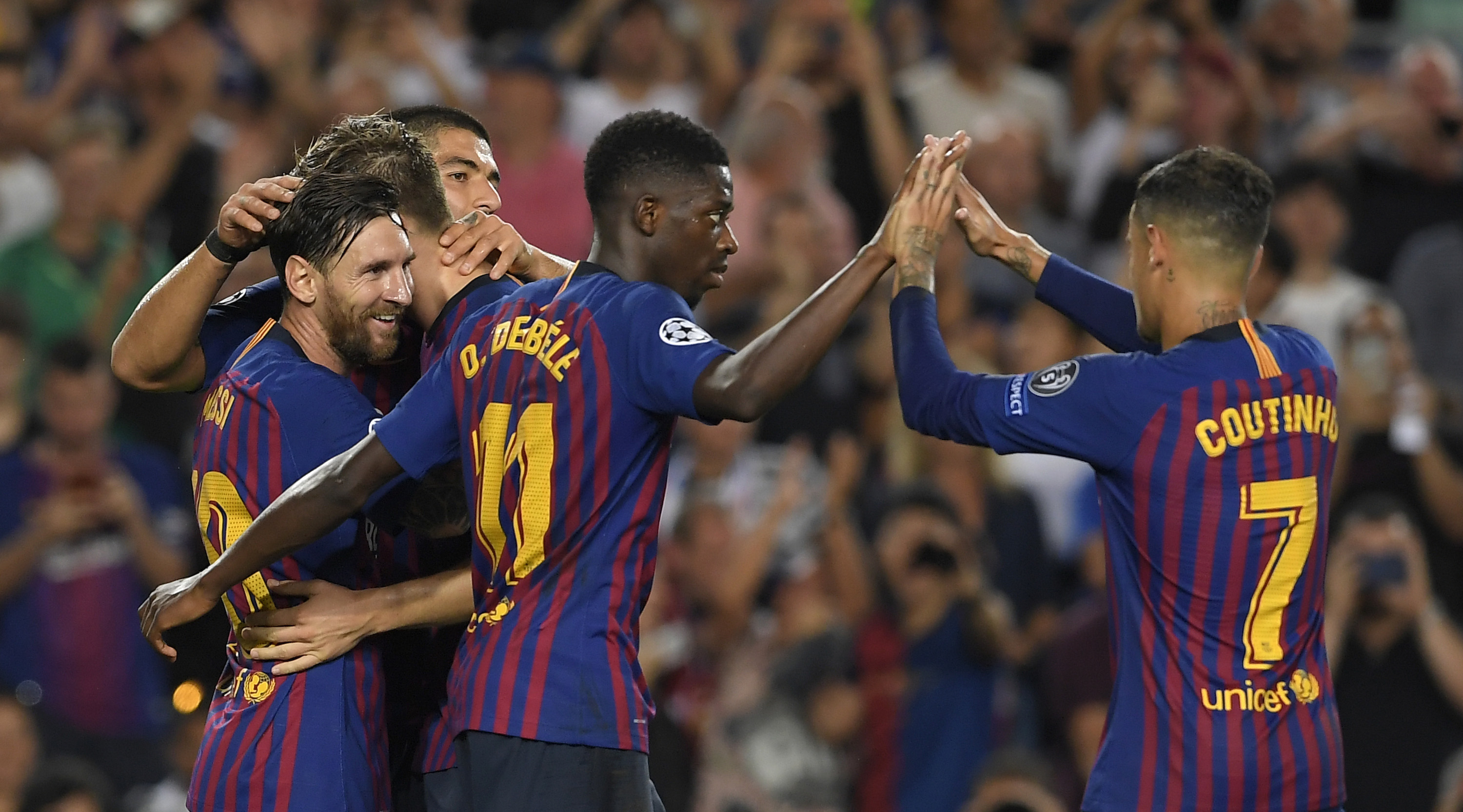 Barcelona's Argentinian forward Lionel Messi (L) celebrates with Barcelona's French forward Ousmane Dembele (C) and Barcelona's Brazilian midfielder Philippe Coutinho after scoring during the UEFA Champions' League group B football match FC Barcelona against PSV Eindhoven at the Camp Nou stadium in Barcelona on September 18, 2018. (Photo by LLUIS GENE / AFP) (Photo credit should read LLUIS GENE/AFP/Getty Images)