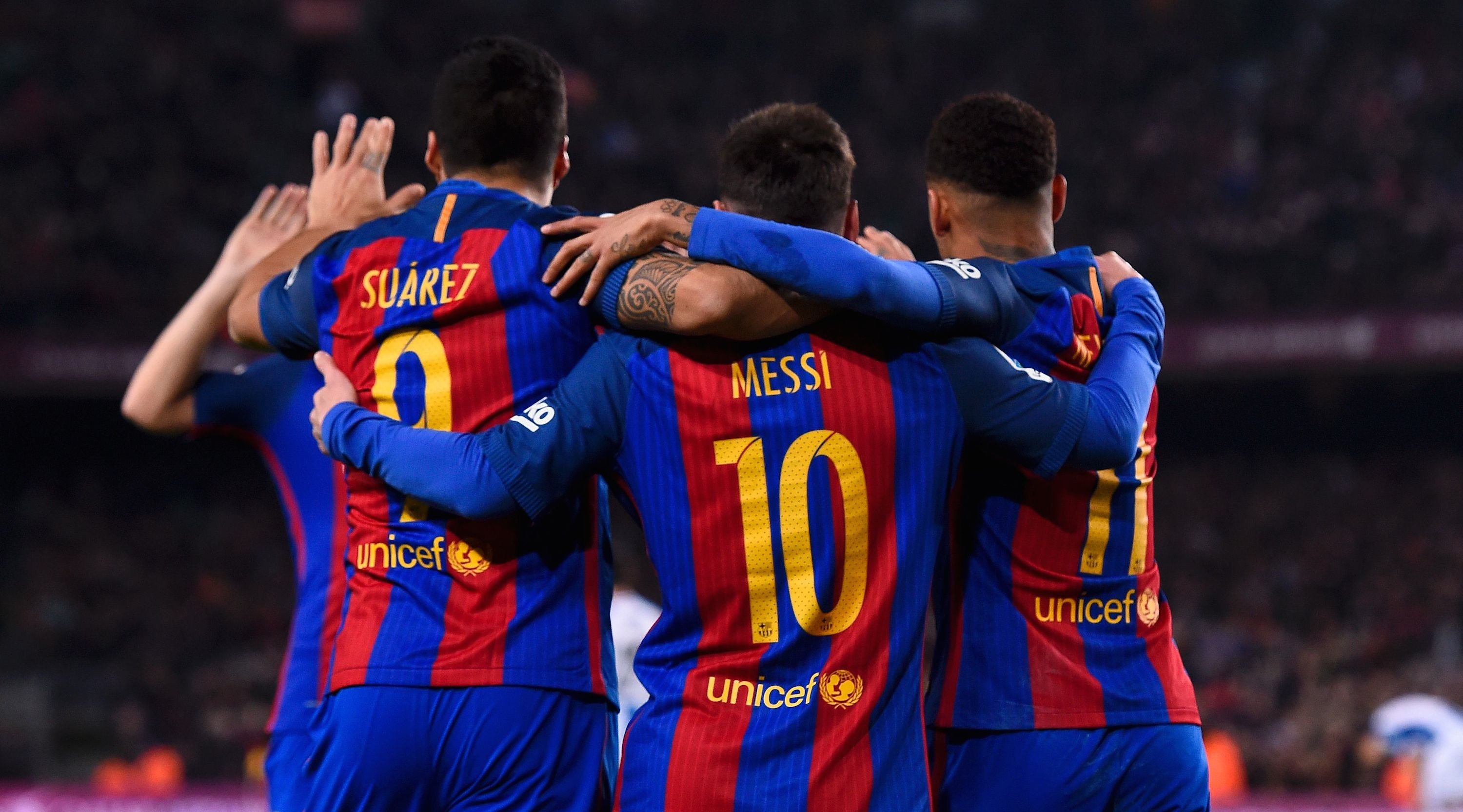 TOPSHOT - Barcelona's Uruguayan forward Luis Suarez (L) celebrates a goal with teammates Argentinian forward Lionel Messi (C) and Brazilian forward Neymar during the Spanish league football match FC Barcelona vs RCD Espanyol at the Camp Nou stadium in Barcelona on December 18, 2016. / AFP / JOSEP LAGO (Photo credit should read JOSEP LAGO/AFP/Getty Images)