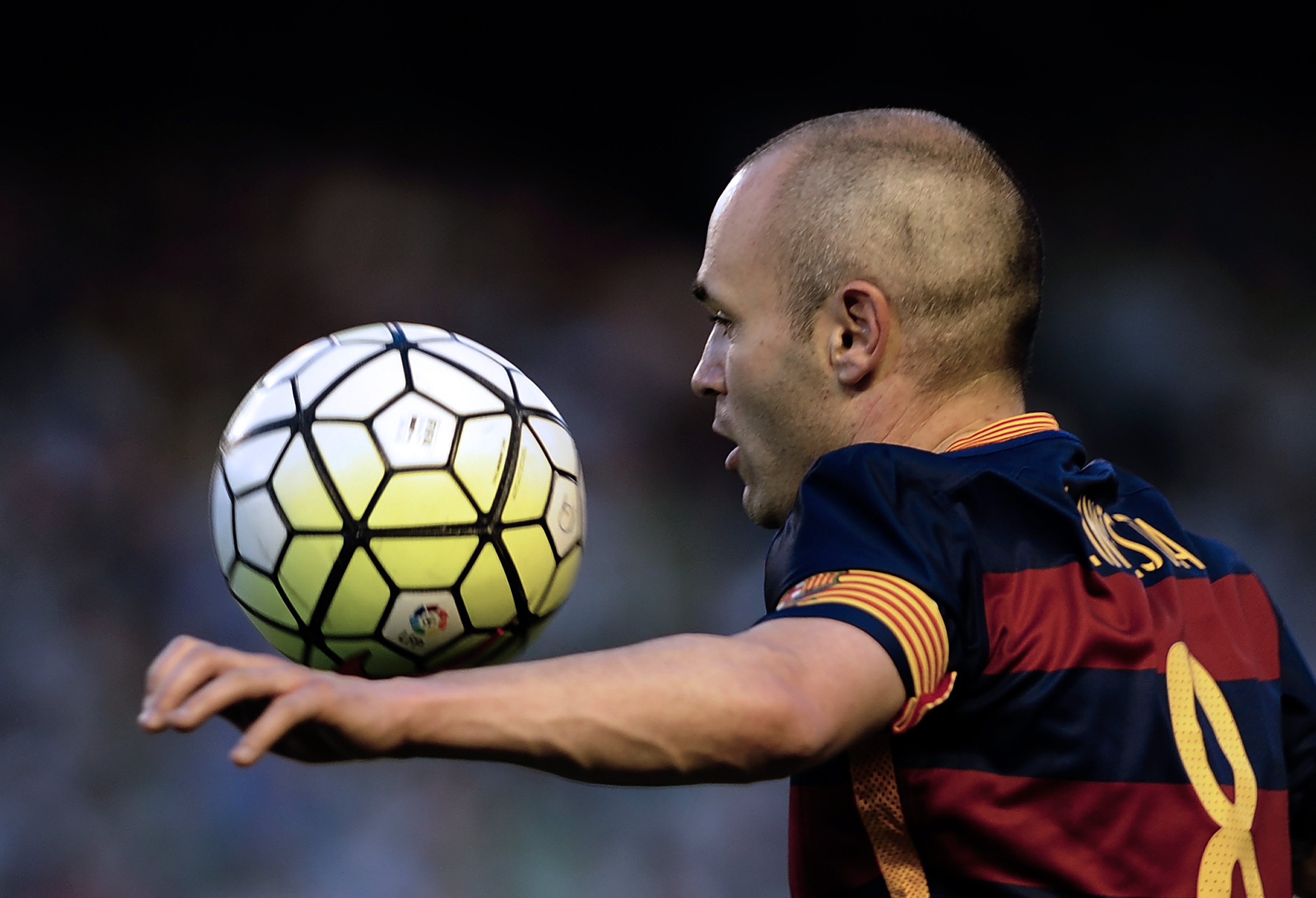 Barcelona's midfielder Andres Iniesta controls the ball during the Spanish league football match Real Betis Balompie vs FC Barcelona at the Benito Villamarin stadium in Sevilla on April 30, 2016. / AFP / CRISTINA QUICLER (Photo credit should read CRISTINA QUICLER/AFP/Getty Images)