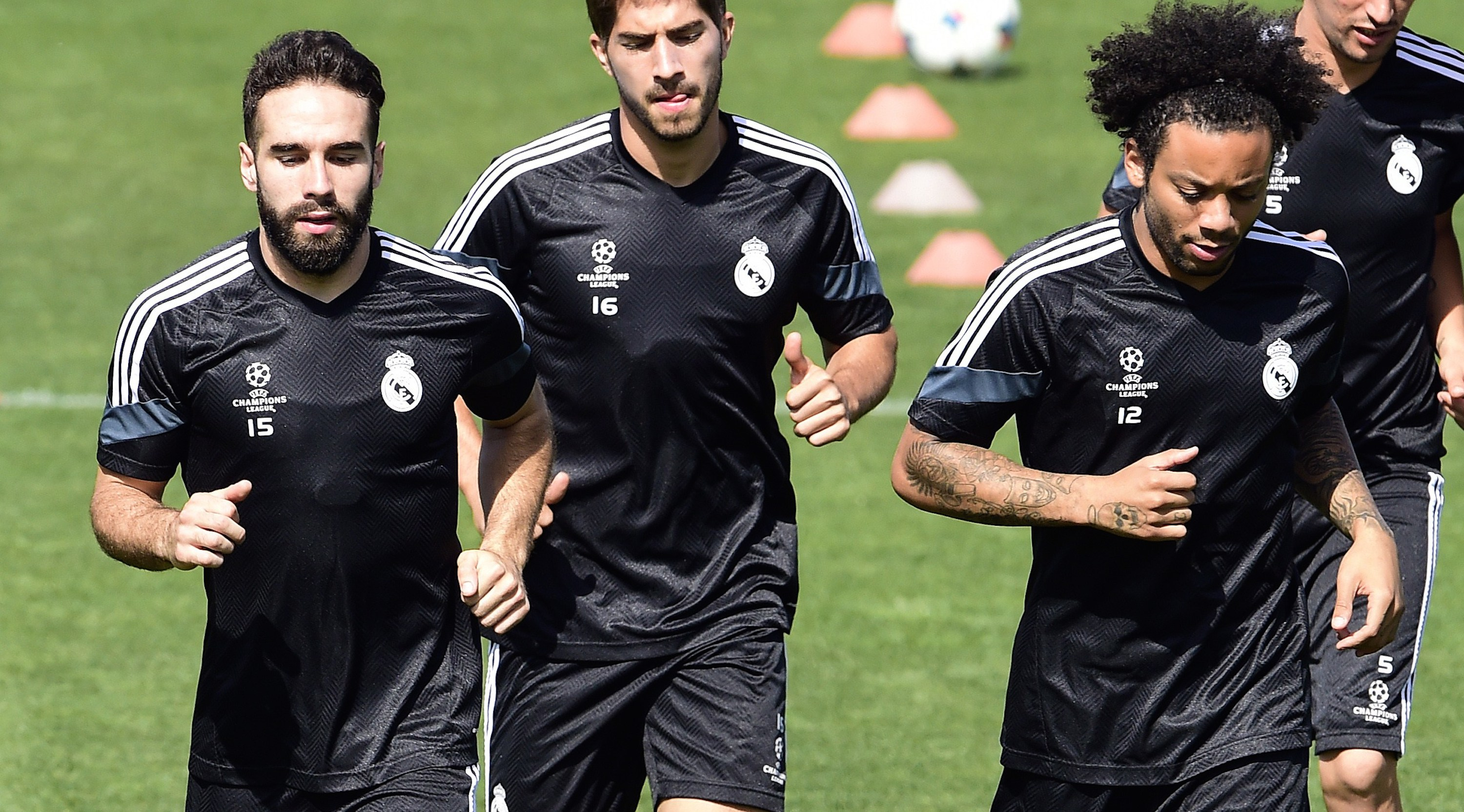 (FromL) Real Madrid's defender Dani Carvajal, Real Madrid's Brazilian midfielder Lucas Silva, Real Madrid's Brazilian defender Marcelo, Real Madrid's Portuguese defender Fabio Coentrao and Real Madrid's Portuguese forward Cristiano Ronaldo jog during a training session at Valdebebas training ground in Madrid on May 12, 2015, on the eve of the UEFA Champions League semi-final second leg football match Real Madrid CF vs Juventus. AFP PHOTO/ GERARD JULIEN (Photo credit should read GERARD JULIEN/AFP/Getty Images)