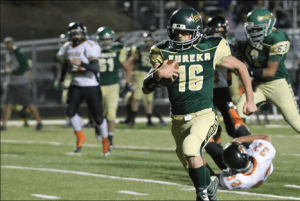 Courtesy photo - Eureka's CW Landry runs for a score against Wells earlier in the year. The controversial game was the Vandals only league defeat thus far. Landry leads the Northern 1A-East in total points scored and touchdowns.