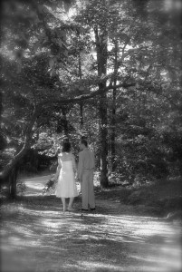 Wedding Couple following wedding in wooded area.