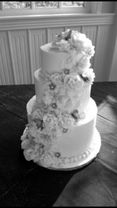 Tiered cake with butterflies and roses.