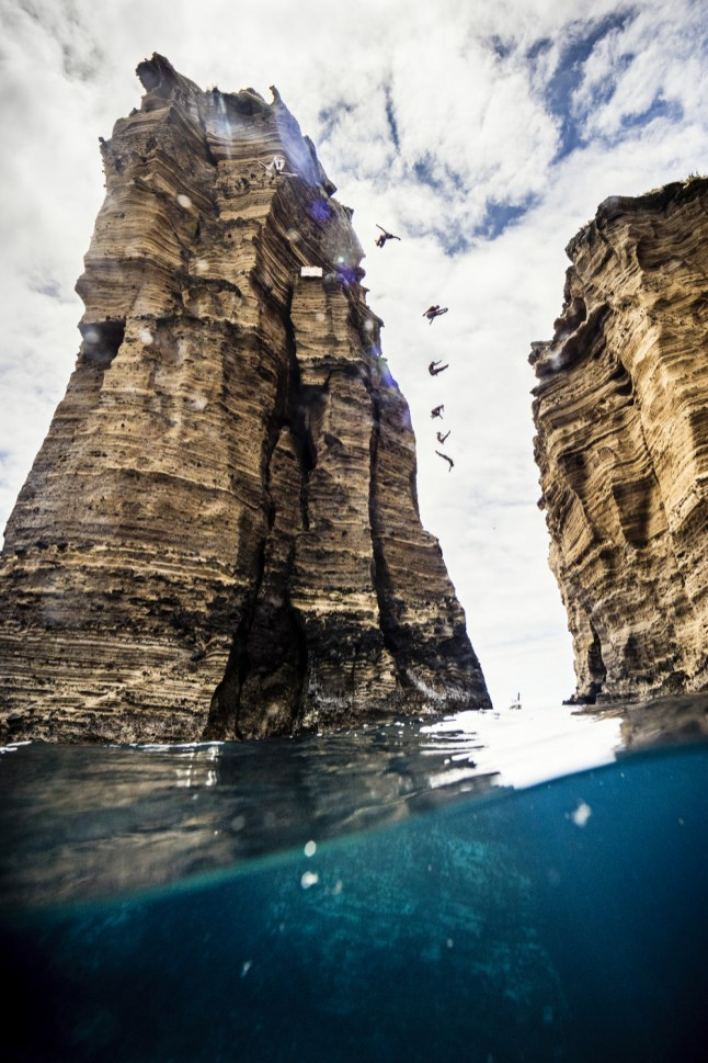 Michal Navratil of Czech Republic, David Colturi, Kyle Mitrione, Cesilie Carlton, Tara Hyer- Tira of the US, Jessica Macaulay of the UK and Todor Spasov of Bulgaria dive from 21 metres cliff on Islet Franca do Campo during the first training session of the second stop of the Red Bull Cliff Diving World Series at Sao Miguel, Azores, Portugal on July 7th 2017. // Samo Vidic/Red Bull Content Pool // AP-1SHN9YN9W2111 // Usage for editorial use only //