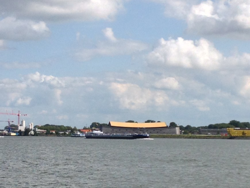 A medium sized (90 m) commercial barge passing in front of Noah's Ark.