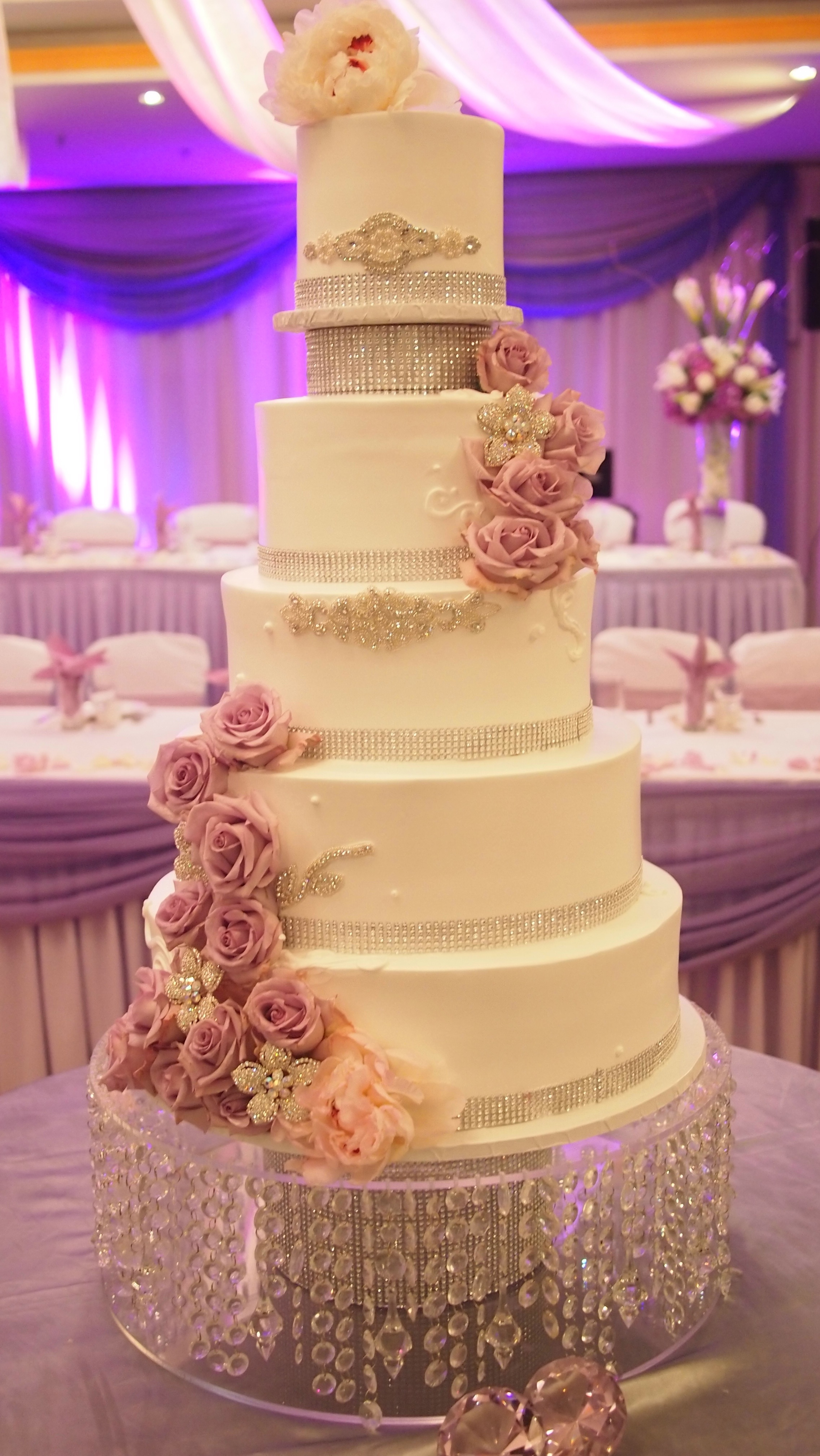 wedding cakes with crystals delights bakery purple roses and stand 26009