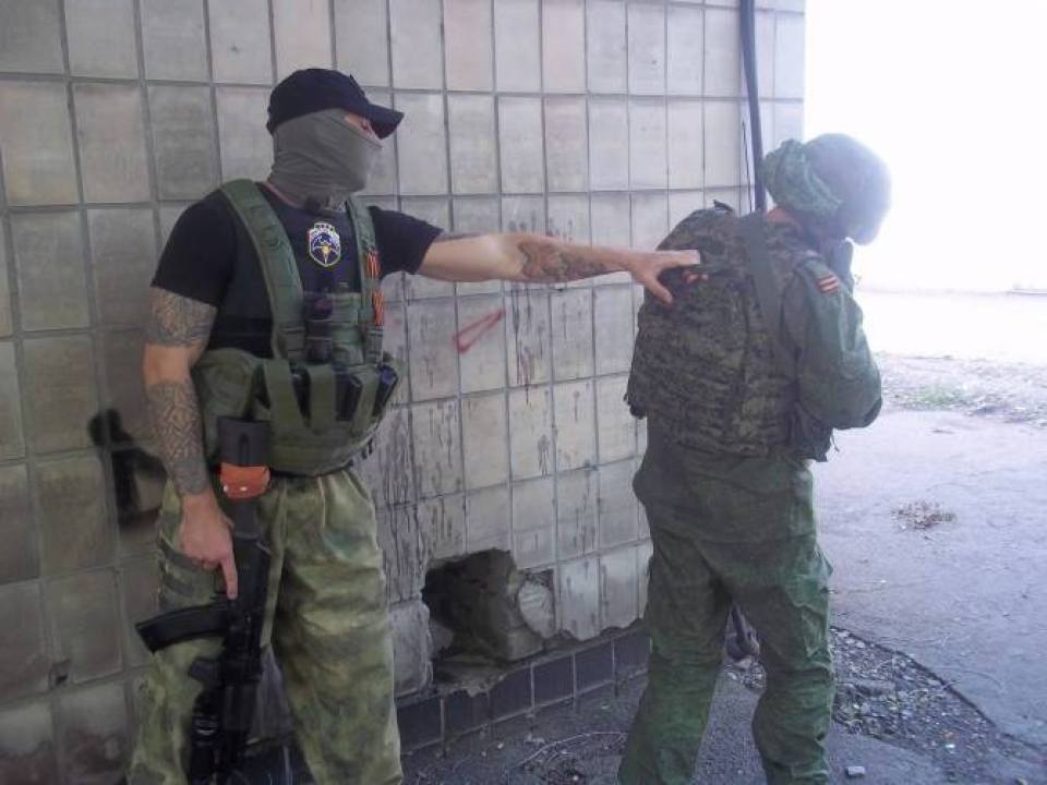 Left: Spetsnaz insignia and neo-Nazi runic tattoos, Right: Man in Russian military issue uniform