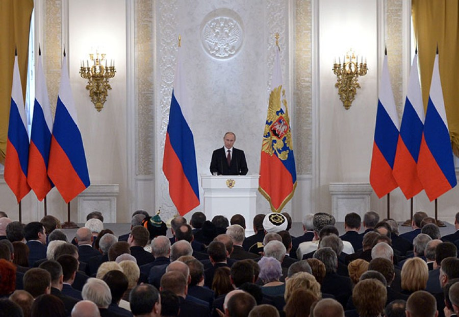 Putin tasking the assembly of Duma deputies, Federation Council members, and the heads of the Russian regions with integration of Crimea into the Russian Federation, March 18, 2014. (Image: Aleksey Nikolskyi/RIAN)