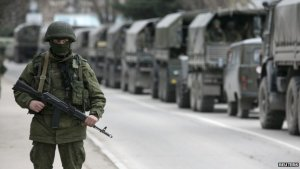 "Trucks with the ""little green men"" - Russian soldiers hiding their identities and without insignia while annexing the Ukrainian peninsula of Crimea"