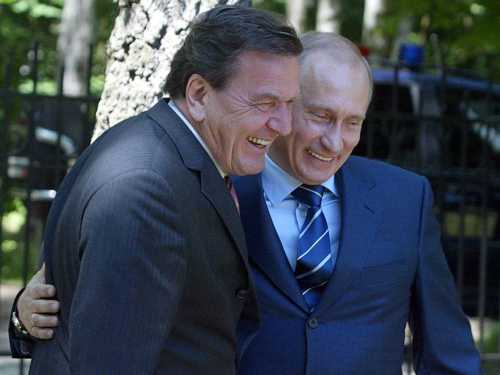Gerhard Schröder, former Chancellor of Germany (1988-2005) who became top GAZPROM representative in the country after leaving his government position, with Vladimir Putin