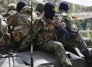 Russian mercenaries drive on an armoured personnel carrier in Slaviansk, Ukraine