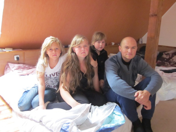 Vasiliy Klimov with three of his daughters; they fled twice.
