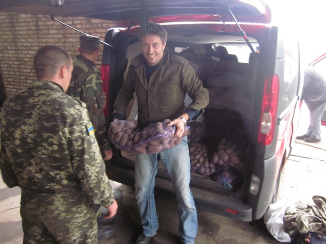 Volunteer Sergey unloads some potatoes for Ukrainian troops on Saturday.