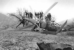 Afghan fighters stand on a downed Soviet helicopter