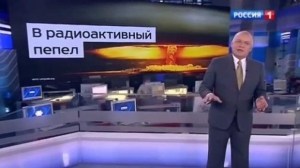 "Dmitry Kiselyov and image of nuclear mushroom cloud, boasting Russia's ability to turn US ""Into Radioactive Dust."" Dmitry Kiselyov is the head of the Kremlin's RT (Russia Today) news agency, a soapbox to promote the Kremlin's policies, denigrate the West and speculate about Western-led conspiracies as well as attack the political opposition to Putin. (Image: screen capture)"