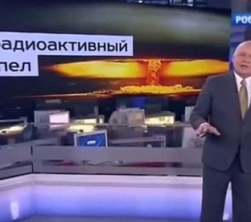 "Head of the Kremlin's RT (Russia Today) news agency Dmitry Kiselyov projecting the image of a nuclear mushroom cloud and boasting Russia's ability to turn US ""into radioactive dust."" RT is the Kremlin's soapbox to promote its policies, denigrate the West and propagate conspiracy theories, as well as attack the political opposition to Putin. (Image: screen capture)"