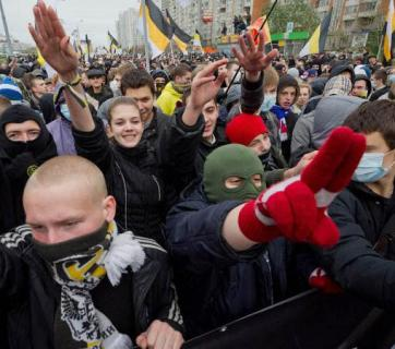 Fascist salutes at the large, Putin government-authorized Russian March in Moscow, Russia