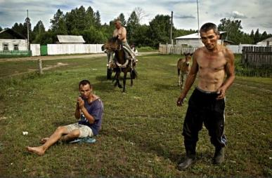 Russia's long-term problem, alcoholism, has become even more widespread during almost two decades of Putin's reign. Drunken villagers in southern Siberia, Russia (Image: rus-img2.com)