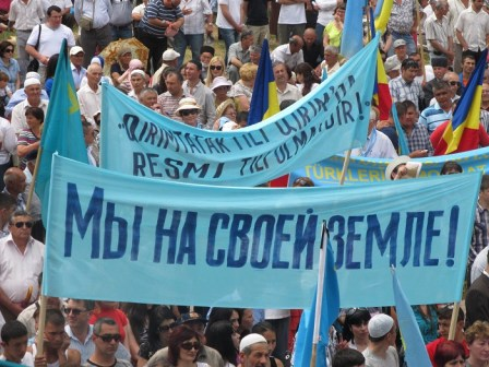 """Crimean Tatar protest. The sign in Russian reads: """"We are on our own land!"""""""