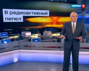 """Head of the Kremlin's RT (Russia Today) news agency Dmitry Kiselyov projecting the image of a nuclear mushroom cloud and boasting Russia's ability to turn US """"into radioactive dust."""" RT is the Kremlin's soapbox to promote its policies, denigrate the West and propagate conspiracy theories, as well as attack the political opposition to Putin. (Image: screen capture)"""