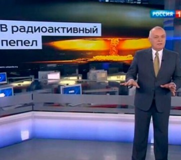 "Head of the Kremlin's Rossiya Segodnya news agency Dmitry Kiselyov projecting the image of a nuclear mushroom cloud and boasting Russia's ability to turn US ""into radioactive ash."" (Image: screen capture)"