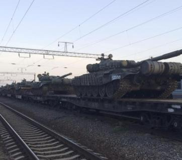 Unmarked Russian tanks are seen on a freight train shortly after its arrival at a railway station in the Russian southern town of Matveev Kurgan, near the Russian-Ukrainian border in Rostov region, Russia, May 26, 2015. Picture taken with a mobile phone. REUTERS/Maria Tsvetkova