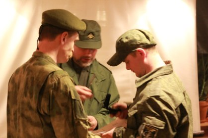 "Stanislav Vorobyov (centre) decorates the fighters of the ""Imperial Legion"" who returned from Eastern Ukraine, St. Petersburg, Russia, 25 April 2015"