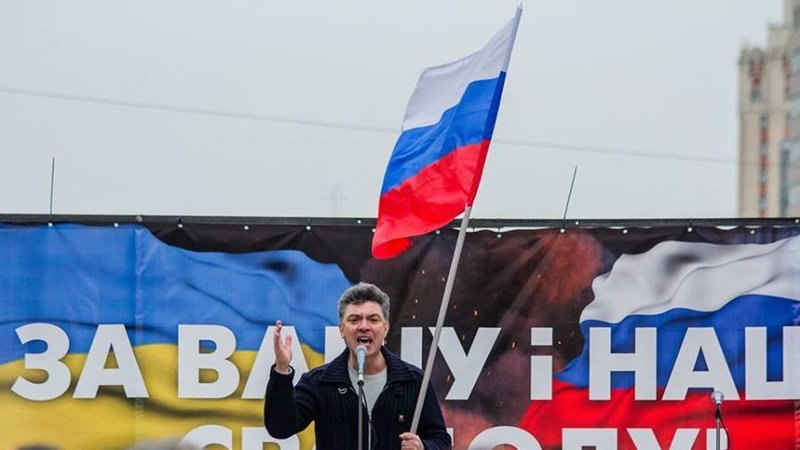 "Boris Nemtsov leads a protest against the annexation of Crimea and the war in Ukraine.  Moscow, March 15, 2014. Banner reads, in Ukrainian: ""For Your Freedom and Ours"""