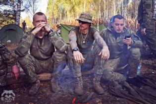 A prominent Russian neo-Nazi Alexey Milchakov (right) with other instructors at the mercenary training camp for Russia's war in Ukraine. Moscow oblast, Russia, September 2015 (Image: ENOT Corp.)
