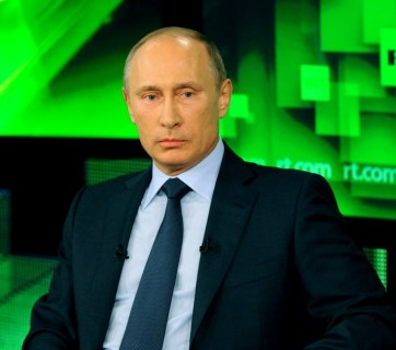 "Vladimir Putin giving an interview to Russian propaganda TV channel RT, formerly known as ""Russia Today"" (Image: screen capture)"
