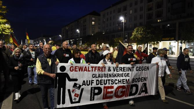 Supporters of PEGIDA attend a protest rally on October 5, 2015 in Dresden, Germany. Photo from Yahoo News.