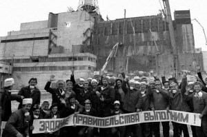 "Nuclear accident mitigation workers near the damaged Chornobyl reactor, 1986. The sign says: ""We Will Fulfill The Task Given by The Party!"" (Image: belaruspartisan.org)"