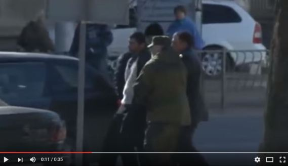 "Snapshot from video where Crimean ""self-defense"" forces abduct Reshat Ametov, who was later found dead"