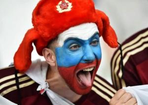 A Russian football/soccer fan making faces while wearing a pseudo-Soviet military fur hat at the 2016 UEFA Euro Cup in France, June 2016 (Image: social media)