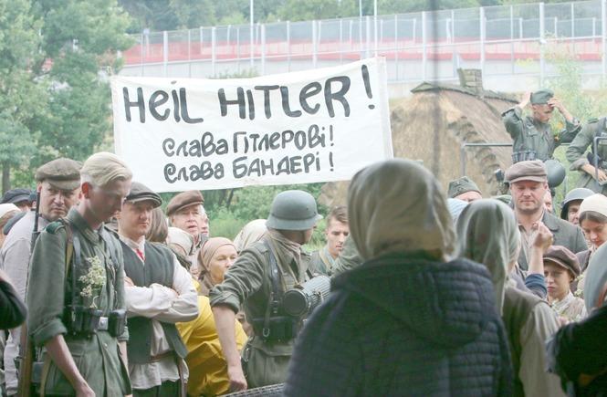 """Movie set of the film Volyn by Wojciech Smarzowski. The poster says: """"Heil Hitler! Glory to Hitler! Glory to Bandera!"""" Photo: MACIEJ KACZANOWSKI / DZIENNIK WSCHODNI"""