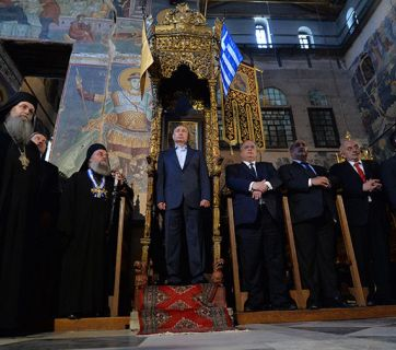 Vladimir Putin visiting Karyes, the Orthodox enclave of Mount Athos in May 2016. The above photo, of Putin standing at an ancient throne alongside Greek officials and Orthodox dignitaries, was described by various Russian news outlets, both within the country and abroad, as Putin standing at a place which had until then been reserved only for Byzantine emperors.