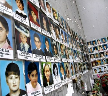 Photos of the killed hostages line up the walls of the Beslan School #1. The European Court for Human Rights has concluded that the Russian troops were responsible for killing the hostages in 2004, not terrorists, as Putin government portrayed it. Over 330 hostages were killed in the massacre, including 186 children. (Image: Wikipedia)