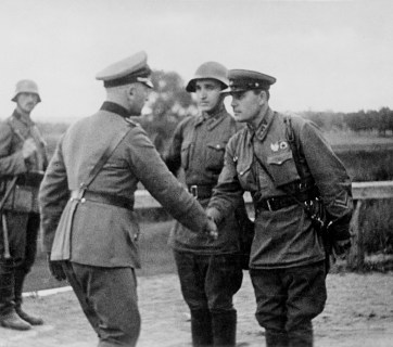 German and Soviet commanders meet at the Nazi-Soviet demarcation line in Poland, after a successful invasion, September 1939