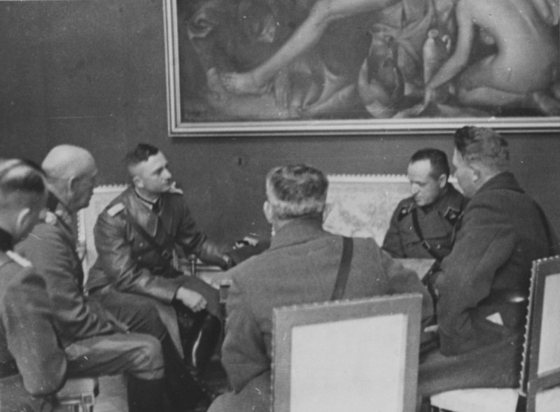 German (L) and Soviet (R) commanders in Poland discuss the Soviet-Nazi demarcation on a map of the conquered country in September 1939. At the time, German troops advanced farther than was agreed in the Molotov-Ribbentrop Pact and had to cede the extra territory to the Soviets.