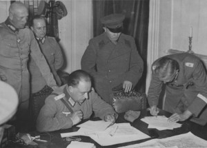 Soviet colonel and German officers discuss the Soviet-Nazi demarcation on a map of Poland. German troops advanced farther than was agreed in the Molotov-Ribbentrop Pact