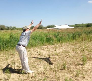 Volunteer instructor Viktor demonstrates launching the UAV at training event